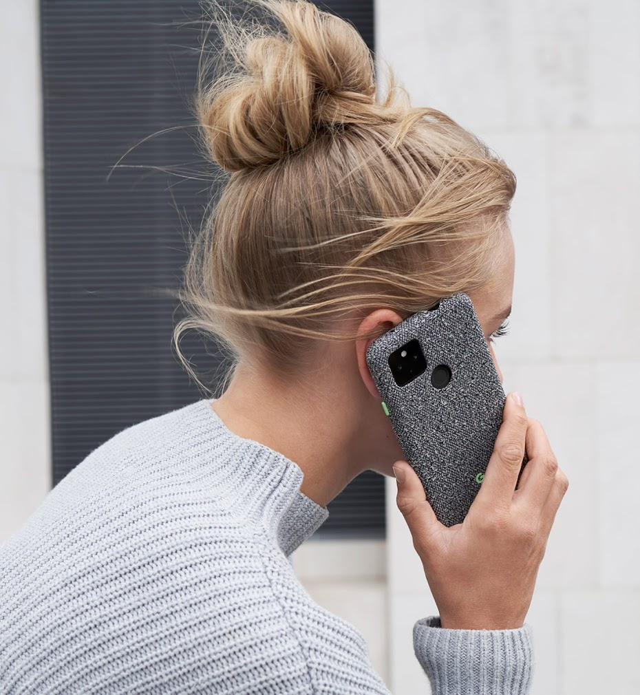 Woman talking on Pixel 4a (5G) with Static Gray case color.
