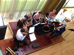Photo: The University Sax Ensemble, directed by Peter Cook, performing on the foyer-stage as part of Jazz Day on day three of Summer Music week.