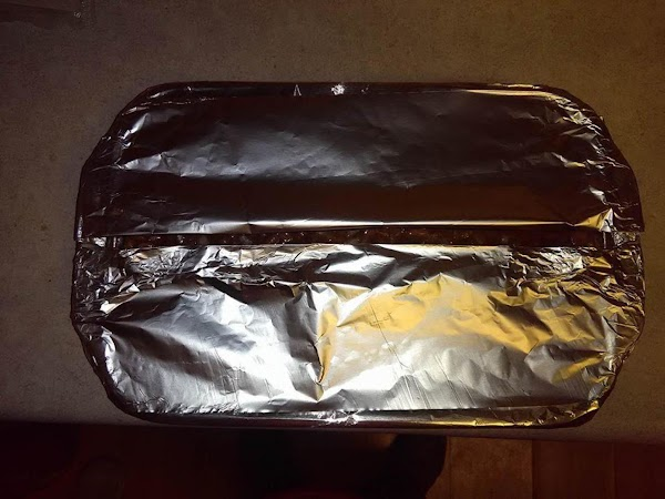 Now place 2 sheets of tin foil one on each side of the dish/pan...