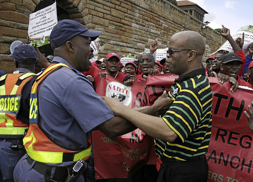 Teachers on the march: South African Democratic Teachers Union members come up against a police cordon at the Union Buildings in Pretoria in this file picture. The ANC has previously called for teaching to be declared an essential service. Picture: PUXLEY MAKGATHO