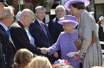 Photo: The Bishop of St Albans, the Rt Revd Dr Alan Smith, greets HM The Queen at Hitchin Station, Hertfordshire, during Her Majesty's Diamond Jubilee Visit