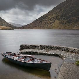 Doo Lough Fishing Boat by John Holmes - Transportation Boats ( sky, stone pier, connemara, mountains, doo lough, clouds, fishing boat, long exposure, water, pier, springb, hills, lake, wall )