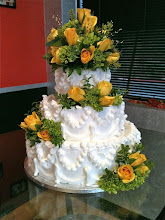 Photo: Classic wedding cake: Lisa's traditional border w/fresh yellow roses & foliage.