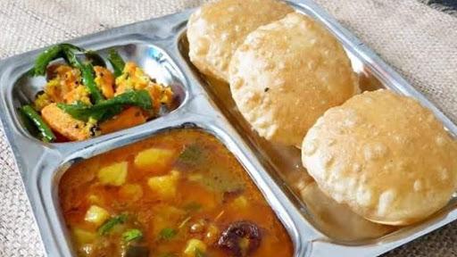 4 Poori With Pickle And Aloo Subzi image
