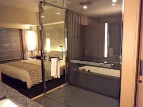 Photo: Bed and the bathroom