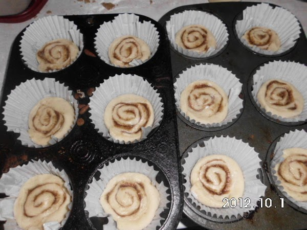 Now place a muffin tin paper in each tin and spray with non stick...