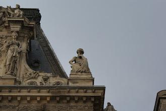 Photo: Contemplative thinker atop the Louvre, Paris