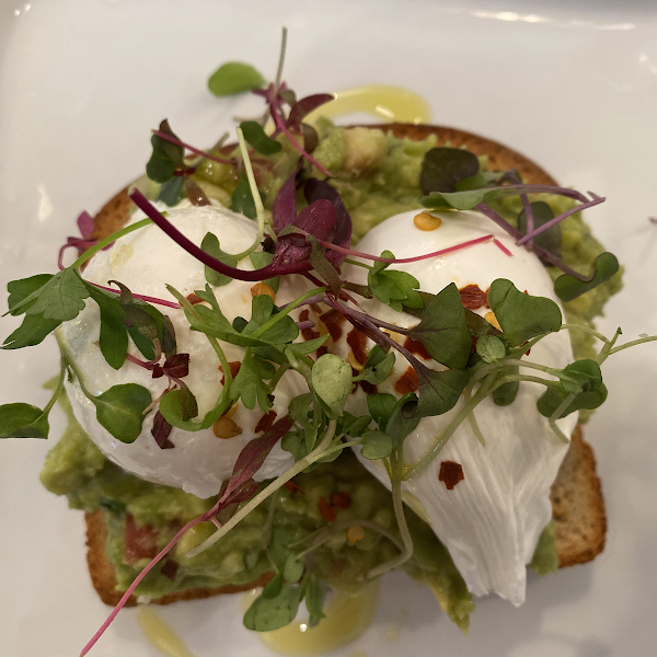 Avocado toast with poached eggs.  Gf bread, yum