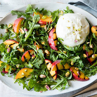 Summer Salad with Grilled Peaches, Fresh Cheese & Pistachios.