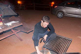 Photo: Daniele starting the fire at our campsite just outside of Monument Valley Navajo Tribal Park, Arizonia and Utah, USA