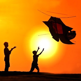 Reaching for Sunset Kite by Alit  Apriyana - Babies & Children Children Candids