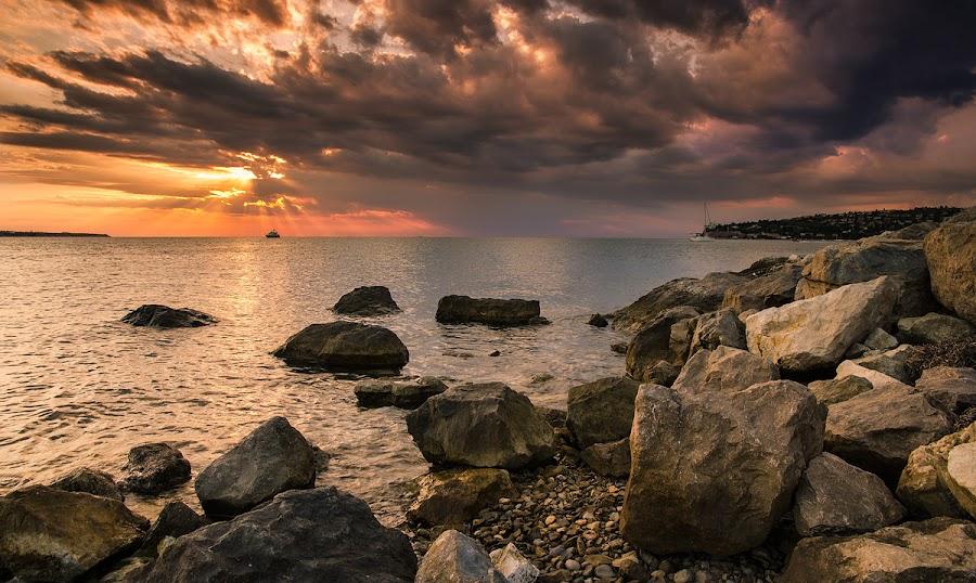 Seca, Slovenia by Peter Zajfrid - Landscapes Sunsets & Sunrises ( clouds, seca, slovenija, sunset, slovenia, beach, boat, rocks, pwcsunbeams, sun, coast )