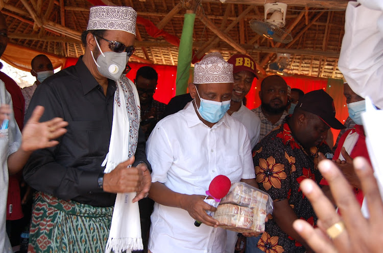 Garissa governor Ali Korane and eldas MP Aden Keynan durring a funds drive in aid of madara institution in Fafi sub county.it was held at a Garissa hotel.