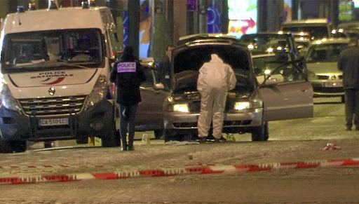 A still from video footage shows police investigators inspecting the car used in an Islamic State-claimed attack on a police vehicle on the Champs Elysees Avenue, Paris, on April 20 2017. Picture: REUTERS/REUTERS TV