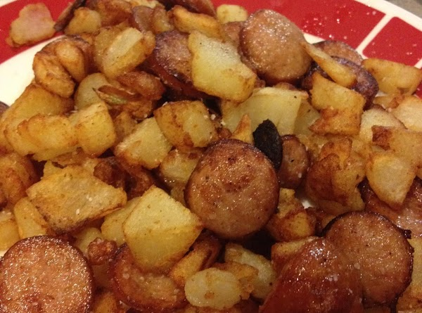 Take pan off and continue cooking potatoes as you mix coins into the potatoes....
