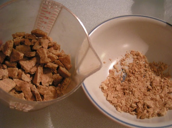 Once ice cream freezer stops stir in graham cracker crumbs and lemon zest; transfer...