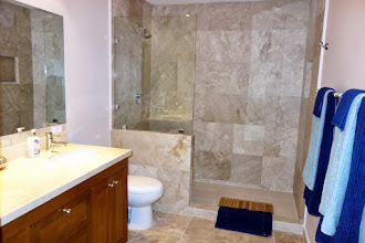 Photo: Spacious bathrooms, with huge walk in showers !