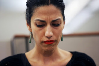 Photo: NEW YORK, NY - JULY 23:  Huma Abedin, wife of Anthony Weiner, a leading candidate for New York City mayor, listens as her husband speaks at a press conference on July 23, 2013 in New York City. Weiner addressed news of new allegations that he engaged in lewd online conversations with a woman after he resigned from Congress for similar previous incidents.  (Photo by John Moore/Getty Images)