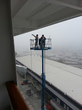 Photo: Crew of the ms Ryndam cleaning the ship. This photo taken from our verandah room 055 on the Navigation deck.
