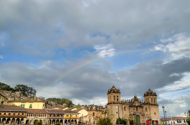 rainbow+behind+plaza+de+armas+cusco+central+square+cuzco+colonial+cusco+cathedral+Cathedral +Basilica+Assumption+virgin+church+compania+de+jesus+cusco+peru+south+america