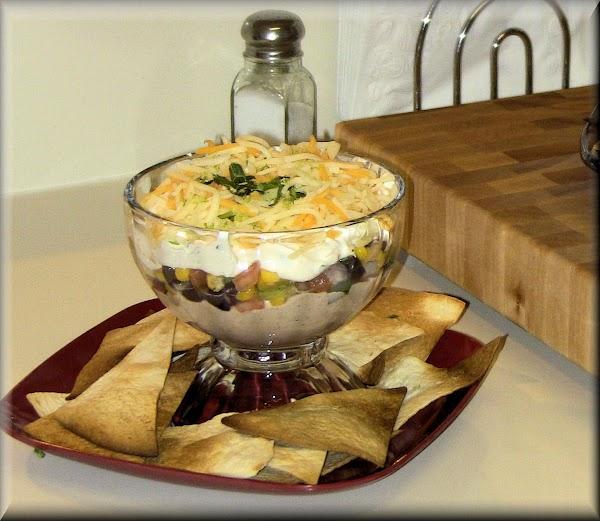 Layer three - combine in a medium bowl: 8 ounces cream cheese, sour cream,...