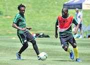 Bafana Bafana players Percy Tau (L) and Aubrey Modiba (R) take part in a training session at Steyn City School in Fourways, north of Johannesburg, on October 9, 2018 .