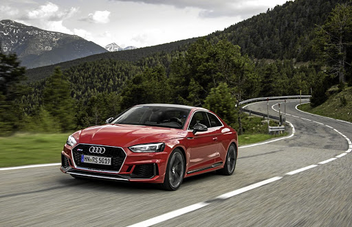 The RS5 gets the brawny looks to intimidate the C63.  Picture: AUDI