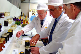 Photo: Bernard Billy Douglas and friend shadowing Bernard Diaper Senior British honey judge in judging liquid honey.