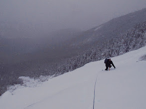 Photo: Kevin above the central ledges in the snowfield.
