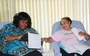 Photo: Taneya & Chris discuss her family tree