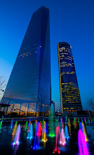 Photo: In the Cuatro Torres Business area in Madrid, they really are Playing with light which is this weeks theme for project 52. The fountains change color all the time, sometimes synchronized to the same color, sometimes to a palette of all colors.  The building to the left is the Torre de Cristal, 249,5 meters high: http://en.wikipedia.org/wiki/Torre_de_Cristal. The building to the right is the Torre Espacio, 236 meters: http://en.wikipedia.org/wiki/Torre_Espacio.  For #2012PROJECT52 by +Giuseppe Basile and +Kate Church and #skysunday by +Randy Scherkenbach and +Patrick Scherkenbach.