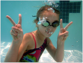 Girl playing underwater at the pool