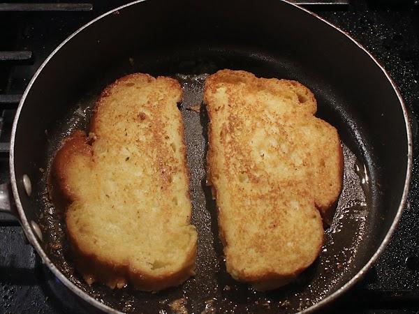 Bread frying in a skillet.