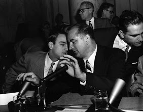 Photo: U.S. Sen. Joseph McCarthy holds both hands over microphones as he speaks to his chief counsel, Roy Cohn, during a hearing of the Senate Investigations Subcommittee in Washington April 22, 1954.  The subcommittee was looking into McCarthy's dispute with top Army officials.  (AP Photo/Byron Rollins)??????????????