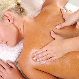 a blonde lady receiving a back massage