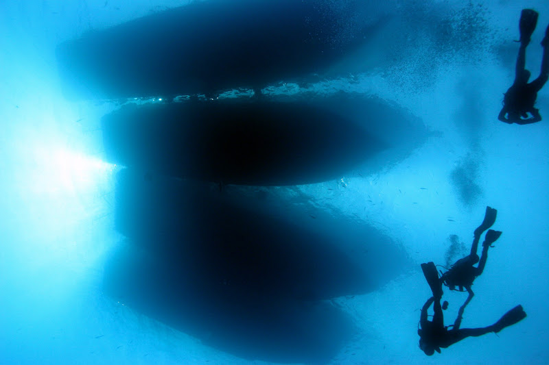 Photo: Silhouetted divers - I was swimming mid-water at around 40 m here and saw these guys above me... no alteration was needed to this image