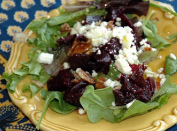 Arrange spring mix in bowl or serving plate.  Top with diced beets, crumbled...
