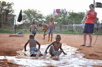 Photo: During a visit to South Africa in December 2012, Hilsinger made a slip n' slide for the children to enjoy.