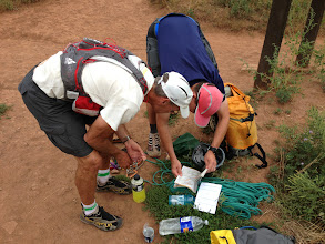 Photo: Repacking gear and plotting a cross-country route after Chris George handed off the support duties to Homie.