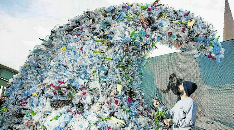 The Corona 'Wave of Waste' sculpture, made of 1,580 metric tons of waste at Federation Square in Melbourne, Australia, Victoria. Sculptures using plastic waste gathered from East London's beaches will be erected at Pinecreek as part of the Big Green Expo next month.