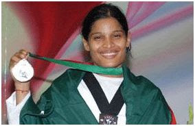 Photo: Sharmin Farjana Rumi  of Panchagarh, clinched the gold medal in women's under-46kg event in taekwondo of the 11th South Asian Games, 2010. [Photo: BDNews24.com]