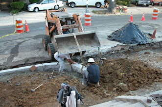 Photo: October 2004 - Month 14: Installing the granite curbs. The city did extensive work on R Street, repaving the road and installing new sidewalks and curbs.
