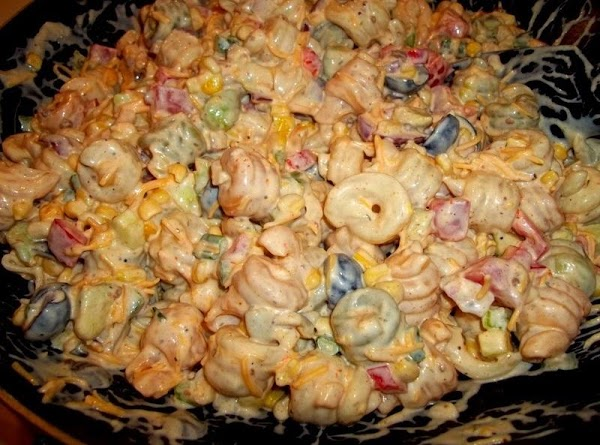 Pour prepared dressing over pasta mixture and toss well to coat all pasta. Salt...