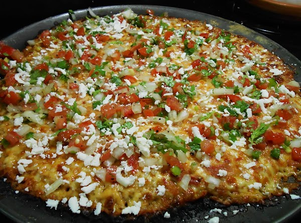 Allow pizza to cool for about 5 min. then top with Pico de Gallo...