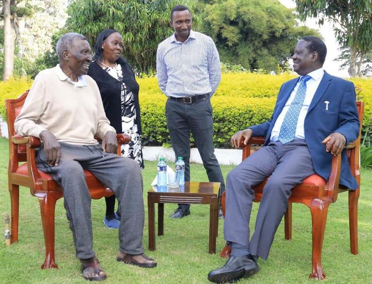 ODM leader Raila Odinga with the late businessman and TNA founder Lawrence Nginyo Kariuki.