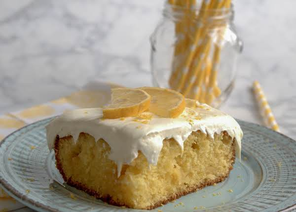 A Slice Of Lemony Lemon Cake On A Plate.