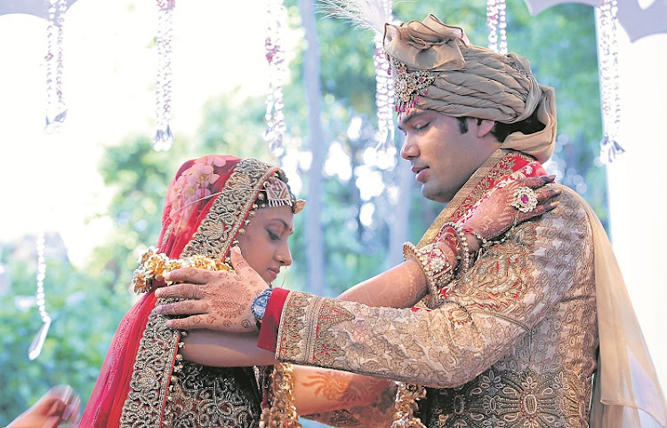 STORMY NUPTIALS: Vega Gupta and Aakash Jahajgarhia at their wedding  ceremony at Sun City in 2013.  Picture: THE HERALD