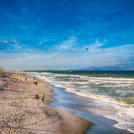 The Golden Hour at Juno Beach by Sandy Friedkin - Landscapes Beaches ( people walking, waves, ocean, beach, golden sun )