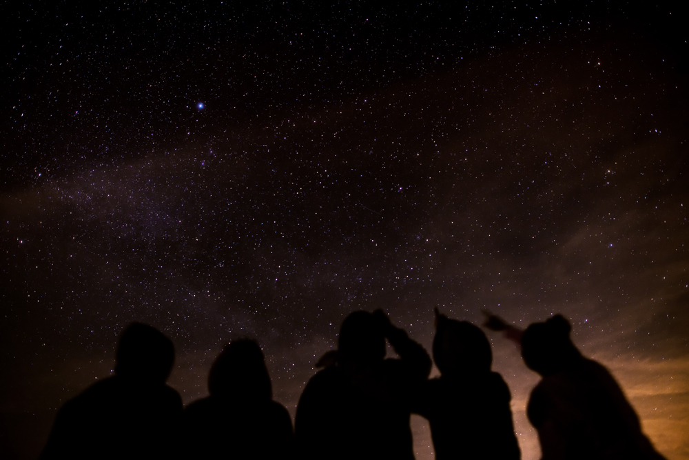 A group of people stargazing