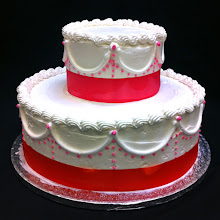 Photo: Pretty in pink wedding cake w/Angela border in hot pink with hot pink ribbon wrap.